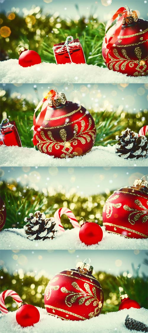 HD Footage - Christmas holiday setting with red baubles and presents laying in snow