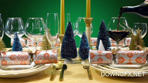 Footage - Festive Christmas lunch table in modern gold, copper, and white theme against a green background
