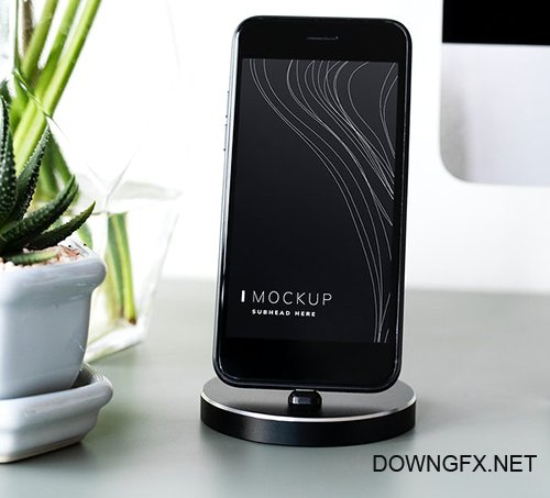 Mockup of a mobile phone on a stand 527570